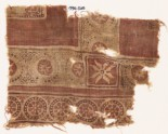 Textile fragment with rosettes in dotted frames (EA1990.528)
