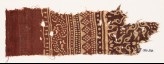 Textile fragment with bands of dotted patterns, vine, and stylized leaves (EA1990.536)