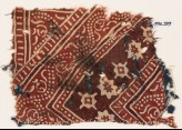 Textile fragment with stylized vine, rosettes, and diamond-shapes (EA1990.539)