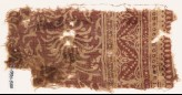 Textile fragment with swirling flower-heads and a dotted zigzag (EA1990.540)