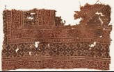 Textile fragment with bands of vines and serrated crosses (EA1990.544)