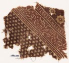 Textile fragment with small and large stars, and a dotted vine (EA1990.549)