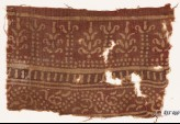 Textile fragment with bands of columns and stylized trees, and a dotted vine (EA1990.553)