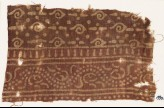 Textile fragment with spirals and dotted vine (EA1990.561)