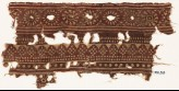 Textile fragment with bands of rosettes and dotted rhombic shapes (EA1990.563)