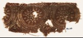 Textile fragment with star-shaped flowers in dotted circles (EA1990.566)