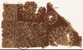 Textile fragment with rosettes in dotted circles, flower-heads, and dotted tendrils (EA1990.567)