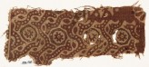 Textile fragment with dotted tendrils and small rosettes in circles (EA1990.568)