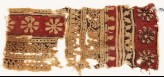 Textile fragment with bands of rosettes and vines (EA1990.583)