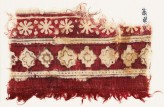 Textile fragment with bands of rosettes, diamond-shapes, stepped squares, and stars (EA1990.584)