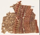 Textile fragment with tendrils, flowers, leaves, and bands with flowers and quatrefoils (EA1990.587)