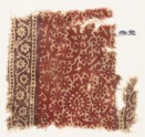 Textile fragment with scroll, flower-heads, and rosettes (EA1990.592)