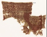 Textile fragment with semicircle, complex rosette, and circle fragment with script (EA1990.597)