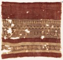 Textile fragment with bands of rosettes, zigzag, and possibly vases (EA1990.600)