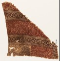 Textile fragment with bands of stylized plants, rosettes, and tendrils (EA1990.604)