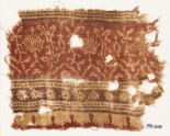 Textile fragment with stylized plants, half-medallions, rosettes, and crenellations (EA1990.608)