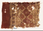 Textile fragment with grid of squares and rosettes (EA1990.609)