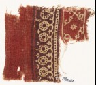 Textile fragment with bands of dotted circles, curves, and crossed tendrils (EA1990.616)