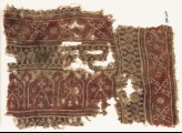 Textile fragment with bands of dotted circles, crossed tendrils, and arches (EA1990.617)