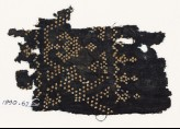 Textile fragment with dots arranged as a band, possibly with a vase shape (EA1990.62)