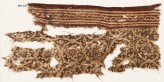 Textile fragment with tendrils arranged as medallions, rosettes, and a vine (EA1990.623)