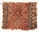 Textile fragment with ornate flower-heads, medallions, and dotted circles (EA1990.626)