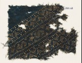 Textile fragment with triangles and S-shapes made of dots