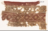 Textile fragment with bands of crossed tendrils, rosettes, and linked squares (EA1990.631)