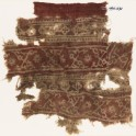 Textile fragment with bands of crossed tendrils, rosettes, and linked squares (EA1990.632)