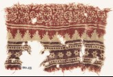 Textile fragment with bands of tendrils, rosettes, and crenellations (EA1990.633)
