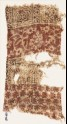Textile fragment with arches, rosettes, and crossed tendrils (EA1990.637)