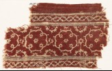Textile fragment with medallions, rosettes, and vines (EA1990.640)