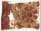 Textile fragment with large medallion, floral shapes, crosses, and circles (EA1990.641)