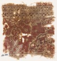 Textile fragment with ornate floral design and a large half-medallion (EA1990.642)
