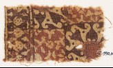 Textile fragment with squares, spirals, and possibly tendrils (EA1990.643)
