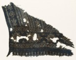 Textile fragment with geometric patterns, diamond-shapes, and zigzags made of dots