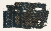 Textile fragment with dots arranged in bands and ovals