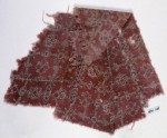 Textile fragment with quatrefoils and stars, probably from a garment (EA1990.718)
