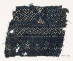 Textile fragment with dots arranged in geometric patterns (EA1990.72)