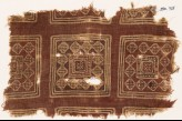 Textile fragment possibly imitating patola pattern, with squares, rosettes, and diamond-shapes (EA1990.725)