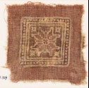 Textile fragment with dotted square and rosette (EA1990.729)