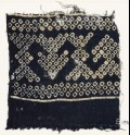 Textile fragment imitating bandhani, or tie-dye, with geometric patterns and arrow-shapes