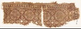 Textile fragment with rosettes and four-pointed stars (EA1990.738)
