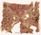 Textile fragment with linked medallions and stars (EA1990.745)