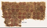 Textile fragment with linked squares, flowers, and tendrils (EA1990.758)