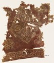 Textile fragment with floral medallion and Persian-style script