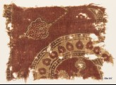 Textile fragment with part of a large circle and leaves (EA1990.775)