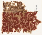 Textile fragment with half-medallion, parts of squares, and flowers (EA1990.781)