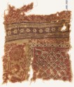 Textile fragment with interlace, floral pattern, and rosettes (EA1990.790)