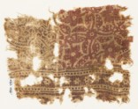 Textile fragment with quatrefoil, stylized stem, and leaf (EA1990.797)